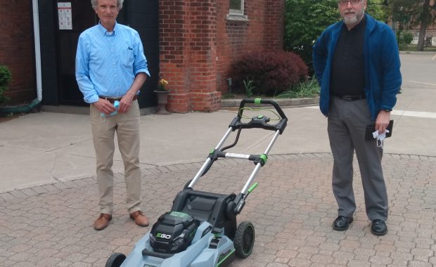 Good neighbour, Peter Walmsley, gifts to the parish new lawnmower.